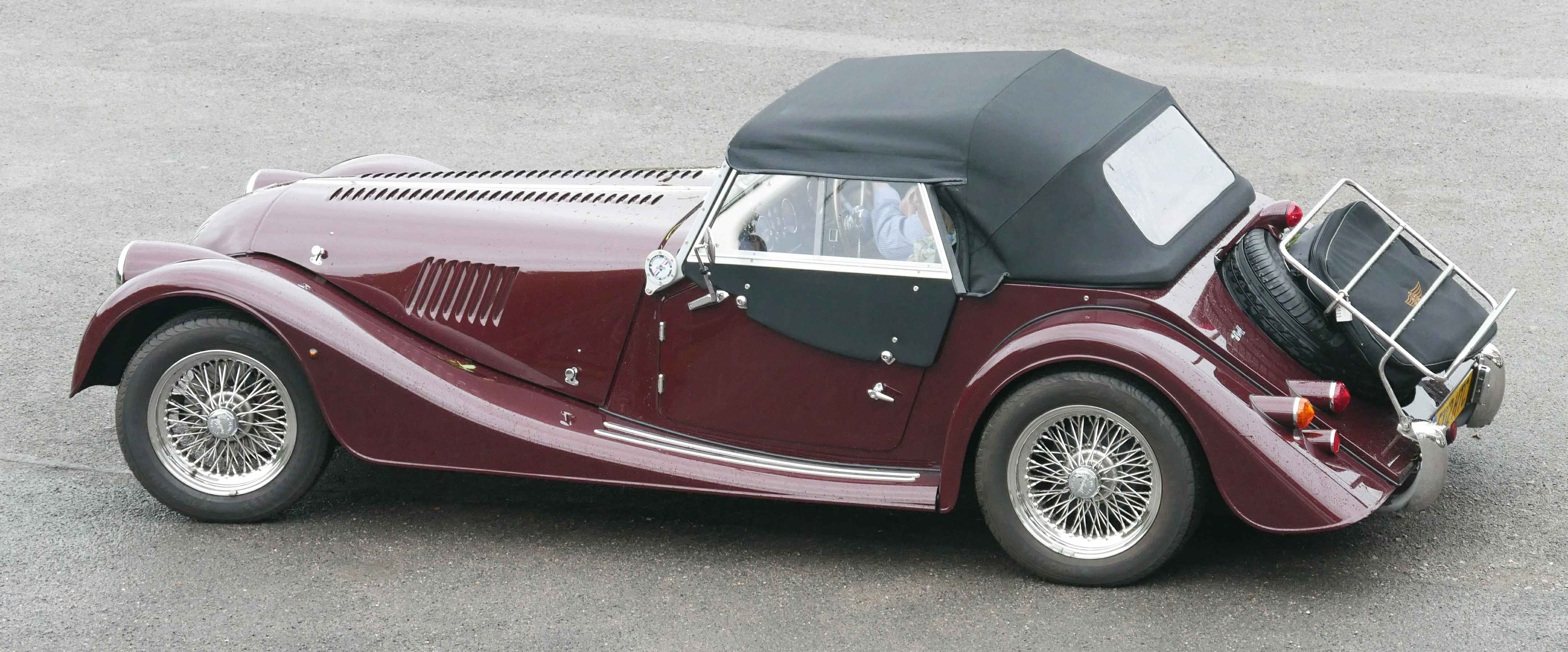 Side view of a traditional Morgan in maroon.