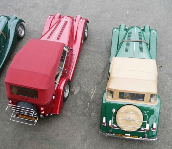 View from above of a four-seater next to a two-seater, both with their hoods up.+4 and a 4