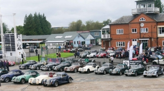 A view of the front of the control tower with lots of Morgans line up in front