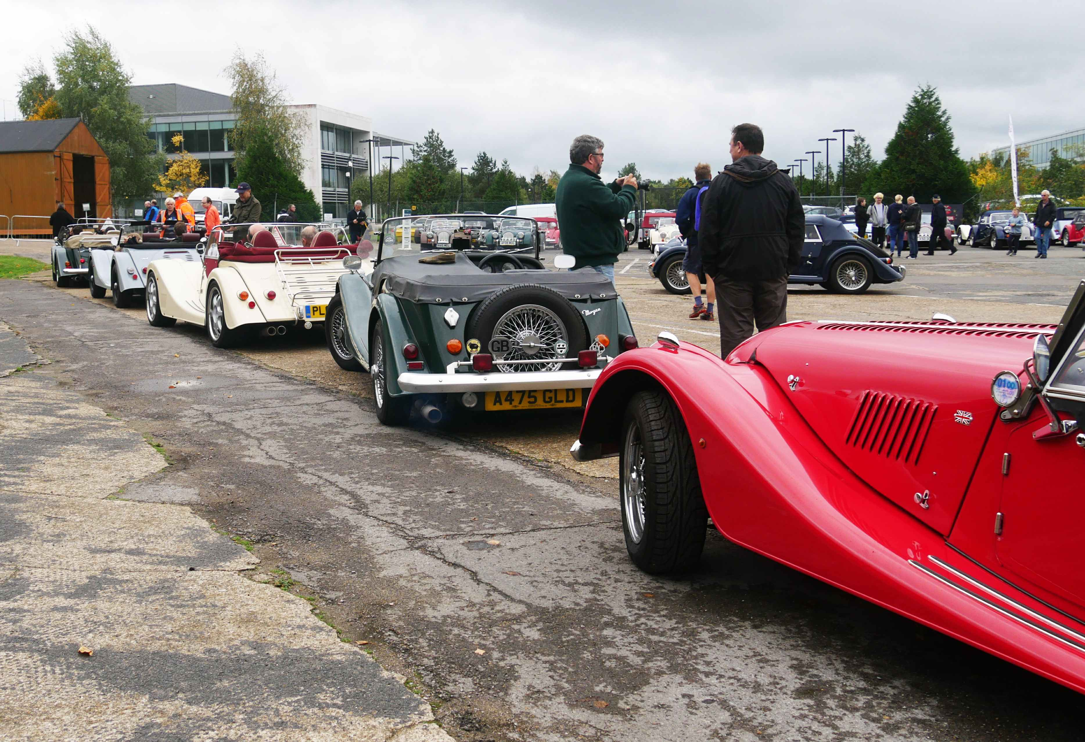 Morgans in a line ready for the hill, with the drivers taking it easy.