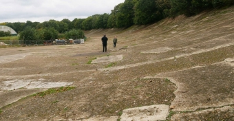 A view of the banking with two people giving scale. It is big.
