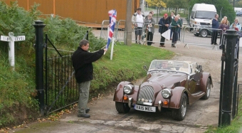 A brown Morgan with a deep shine being flagged off up the hill.