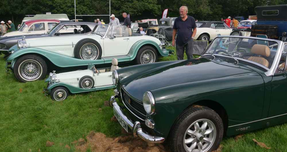 An MG Midget with the kit car based on it in the background and the kiddy replica in between